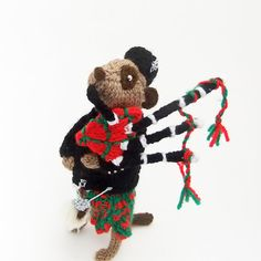 Scottish Piper Meerkat playing bagpipes for Burns Night - (I love Nifty Knit's adorable Meerkats!)