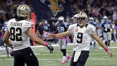 New Orleans Saints quarterback Drew Brees (9) celebrates with tight end Coby Fleener (82) after the ... - AP Photo/Bill Feig