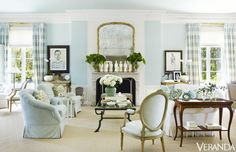 Plaid curtains, blue walls, white trim
