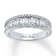 This picturesque anniversary band from Neil Lane Bridal® features a row of baguette diamonds accompanied by rows of round diamonds above and below. Styled in white gold, the ring has a total diamond weight of 1 carats. Diamond Bands, Diamond Wedding Bands, Gold Bands, Platinum Wedding Rings, Morganite Engagement, Engagement Rings, Neil Lane Bridal, White Gold Jewelry, Anniversary Bands