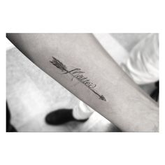 I love this arrow with script tattoo, different wording but the design is beautiful in its simplicity.