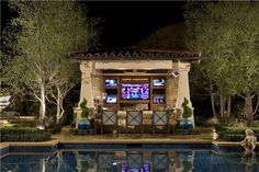 Watch the big game from the pool! This outdoor entertainment center designed by AMS Landscape Design Studios in Newport Beach, CA. For more photos of technology in the landscape visit: http://www.landscapingnetwork.com/pictures/technology-in-the-landscape_58/92660-ca-ams-landscape-design-studios-outdoor-bar_1700/