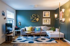 Deep turquoise walls. Love the statement. From...Chris & Meg's Darling City Cottage