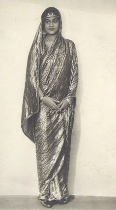 daughter of the royal family of Sir Bijay Chand Mahtab, Maharaja Bahadur of Burdwan.  Elegant and composed as she look in fashionably narrow saree. 1927