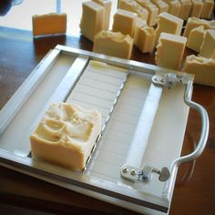 A soap cutter this site has neat ideas for soap makers