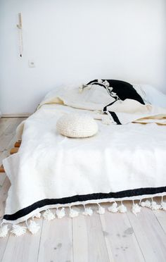 Moroccan POM POM Wool Blanket Ecru and stripe BlackBeautiful Moroccan Blanket Wool, with pompoms on two sides. Handmade in Marrakech. Poms poms are on the top and bottom of the blanket.: Color: Ecru and stripe Black. Dream Bedroom, Home Bedroom, Bedroom Decor, Bedrooms, Modern Bedroom, Bedding Decor, Bedroom Inspo, Bedroom Ideas, Design Hotel