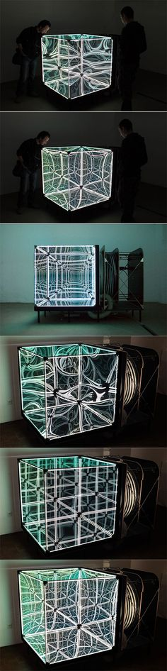 Built and designed by Numen/For Use, N-Light Membrane is a giant cube with three out of the six surfaces made of flexible membrane (foil mirror) with an air tank and a compressor connected to it. The other three mirrors are semi transparent spy-glass. By inflating or deflating the air tank, the membrane turns convex or concave, deforming the reflections within.