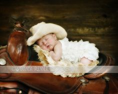 Is this not one of the cutest pictures you've ever seen?!  (Ravelry: 0-6 Month Cowboy Hat pattern by Janel Feathers)
