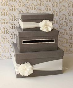A card box for your wedding. You can buy this one on Etsy for $115.00 by clicking on the picture or you can make your own by covering cardboard boxes with a nice fabric and embellishments for $30 tops (and I bet I could do it for under $20). I obviously recommend the second option.
