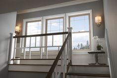 6 Ways to Bring More Sunlight into a Home  Natural light coming from windows and doors is a great source for general and task lighting. Plus, the strategic placement of windows can reduce the need for artificial lighting during daylight hours,  Come and see how to use these 6 tips in your home remodel project. One tip is using Staircases! Three Tuscany Series single hung windows on the second floor of a home.