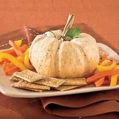 The Great White Pumpkin Cheese Ball {Southern Living}.The Great White Pumpkin Cheese Ball A perfect appetizer and conversation piece, this pumpkin-shaped cheese ball is made with a yummy mix of white Cheddar, cream cheese, and goat cheese. Pumpkin Cheese Ball Recipe, Cheese Ball Recipes, Appetizer Recipes, Appetizer List, Appetizer Dishes, Cheese Pumpkin, Halloween Party Appetizers, Halloween Food For Party, Halloween Treats