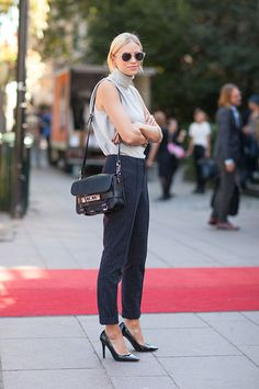 Boyish and elegant. I like the looser fit of the sleeveless turtleneck.