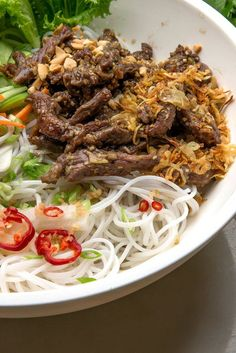 Bun Bo Xao, a zesty stir-fry of marinated beef hot from the wok paired with room temperature rice noodles, makes a satisfying main-course salad year-round Dressed with a classic Vietnamese dipping sauce and topped with roasted peanuts, the flavors are clean, bright and restorative Yes, this recipe calls for a lot of ingredients, but the prep is simple, and it's an easy introduction to Vietnam cooking for the uninitiated.