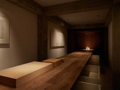 Sushi Yoshii, Tokyo - When the owners of sushi restaurant Yoshii began discussions with the architects at Suppose Design Office to create their new restaurant, one essential component of the sushi dining experience came into focus: the counter.