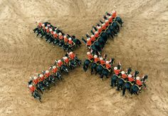 Royal Canadian Mounted Police in X Formation during Musical Ride, very Straight Lines on Horseback !