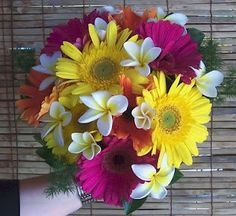 I like this pretty and tropical looking gerbera daisy wedding bouquet.