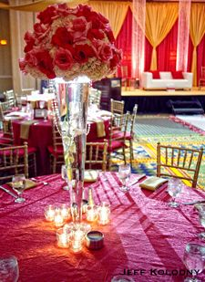tall wedding centerpiece - I think this is what it will resemble but with all fuschia peonies, roses and other flowers - this is on a trumpet vase