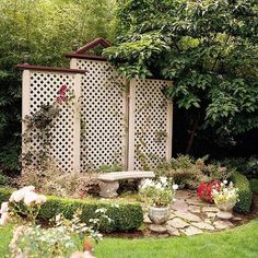 Lovely sitting area in the garden with these three lattice screens, the middle one topped with a gable