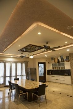 Perfect ceiling for dining area with fan and chandelier.