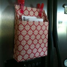 Cereal box covered with scrapbook paper. Hang with magnets on the fridge or stand on counter beside the phone. Great place for the mail or takeout menus.