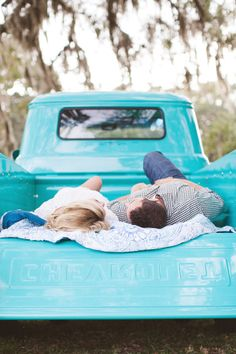 Couple in Turquoise Truck Bed | photography by http://www.jlaynephotography.com/