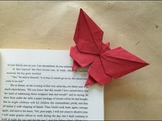 origami butterfly bookmark. Link download: http://www.getlinkyoutube.com/watch?v=i6TWb_o6ef0