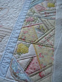 Crazy quilting in only a few of the blocks on the quilt.  Really like that idea!