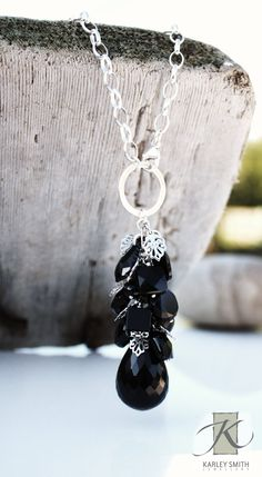 """Faceted black onyx, jet Swarovski crystals, and rhodium plated leaves finished with sterling silver.  Heavy oval chain adjustable to 24"""" long. Style #2528-N1"""