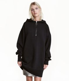 Black. Long sweatshirt with a jersey-lined hood. Zip at top, dropped shoulders, long sleeves, and ribbing at cuffs and hem. Soft, brushed inside.