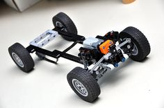 After watching a hour documentary on rally racing, I think it's time I build my own rally car. The front suspension is already complete: a front McPhers. Lego Technic Truck, Lego Technic Sets, Lego Truck, Amazing Lego Creations, Lego Mindstorms, Lego Mechs, Lego Military, Lego Design, Lego Projects