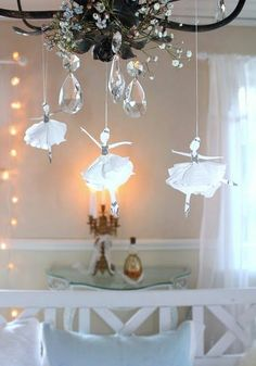 Beautiful shimmery ballet dancers hanging from a chandelier