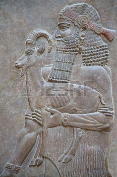 Ancient sumerian stone carving with cuneiform scripting Stock Photo