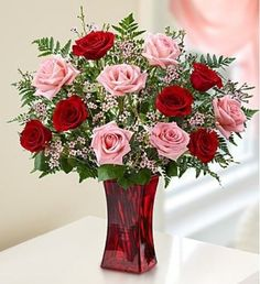 She 'll be blushing for sure when our beautiful bouquet of pink and red long-stem roses arrives at the door! Hand-gathered by our expert florists in a rich red vase, we can 't think of a more colorful way to express yourself to someone very special.