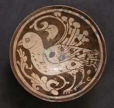 Bowl    Date:      12th–13th century  Geography:      Iran, Rayy  Medium:      Stonepaste; luster-painted on opaque white glaze with monochrome decoration under transparent glaze  Dimensions:      H. 2 1/2 in. (6.4 cm) Diam. 5 7/8 in. (14.9 cm)   Classification:      Ceramics