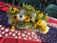 2017   Dotted table runners and yellow and white floral arrangements for our lawn centerpieces were perfect for the concert, Remembering the Summer of Love.