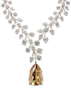 "a38ee64434157 The statement gem on the gold necklace is the ""Incomparable"" diamond. The  natural fancy deep-yellow shield step‐cut diamond is the largest internally  ..."