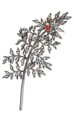 Boucheron - An Antique silver-topped gold, diamond and ruby en tremblant brooch, circa 1890. With French assay marks and maker's mark `FB' for Frédéric Boucheron. #Boucheron #antique