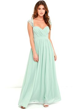 The romance is palpable when your start the evening off in the Novela Sage Green Lace Maxi Dress! Floral lace shoulder straps lead into a scalloped lace back, supporting a princess-seamed, surplice bodice with a sweetheart neckline. Banded empire waist flows into an elegant woven maxi skirt. Hidden side zipper with clasp. Second clasp closure along the lace at back.
