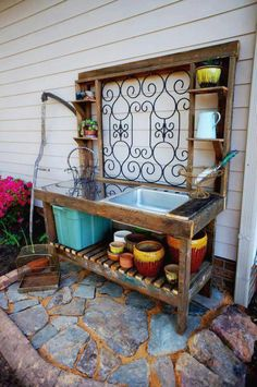 Potting bench with a sink!? Also, if I had water out there, I could do an outdoor shower....hmmmm!
