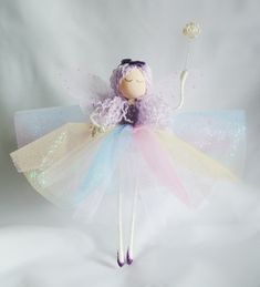 Say hello to Lavender, she's very excited to meet you. Se measures approximately 8 inches tall and is super light so she will sit on your tree perfectly. Lavender has lilac sparkle hair with a purple velvet bow on top. Lilac, Lavender, Pink, Postage Bags, Glitter Pumps, Beautiful Fairies, Fairy Godmother, Purple Velvet, Fairy Dolls