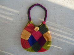 I had already repurposed some of the squares and made them into this felted bag which garnered a first prize at the North Carolina State Fair.