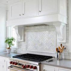 Normandy Remodeling - kitchens - wood panel kitchen hood, white corbels, herringbone tiles, herrinbone backsplash