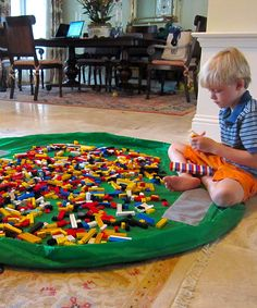 Lay-n-Go: Play mat with drawstring that you can cinch up with toys inside, then put away for next time!