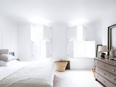Bedroom with white shutters. In the 'Fulham House' by Daniel Lee. Photo by Rory Gardiner. Transitional Home Decor, Transitional Living Rooms, All White Bedroom, White Bedrooms, White Shutters, Wood Shutters, Turbulence Deco, Contemporary Bedroom Furniture, Interior Windows