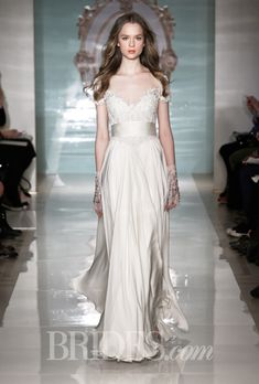 Brides.com: Reem Acra - Spring 2015. Satin chiffon A-line wedding dress with an embroidered illusion sweetheart bodice, short sleeves, and a ruched waistband, Reem Acra