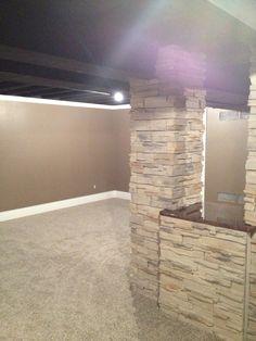 Finished basement  I love the idea of adding stone to the pole