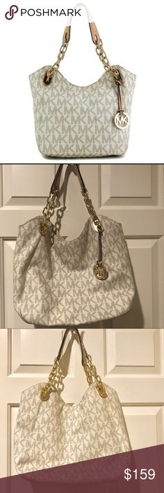 "SALE!! 🎉MK beautiful Vanilla Large Lily bag 💕 Beautiful Michael Kors Vanilla Signature Large Lily bag 💕🌺 Measurements 15""L x 6""H x 12""W. Excellent condition no tears or stains. What you see is what you get. I'm including pictures of ever angle of bag as well as the interior to show the great and beautiful condition of this bag. It's the perfect size bag. Remember to bundle and save 😊 Michael Kors Bags Shoulder Bags"