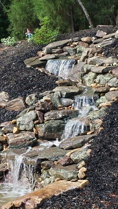 Custom design natural streams by All Natural Streams Landscaping. Sloped Backyard Landscaping, Waterfall Landscaping, Garden Waterfall, Waterfall Fountain, Ponds Backyard, Backyard Waterfalls, Florida Landscaping, Backyard Water Feature, Water Features In The Garden