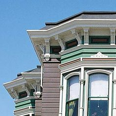 Photo: Bob Buckter, Architectural Color Design | thisoldhouse.com | from How to Get the Best Curb Appeal on the Block    This Old House on-line says that 2 coats of acrylic paint blended the roof color and extended the life of the roof.  Hmmmm.  I have a ~~RED~~ roof.