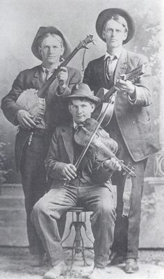Wylie Eoff with two unidentified musicians